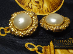 Vintage CHANEL golden faux pearl earrings.
