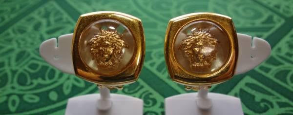 SOLD OUT: Vintage Gianni Versace clear and gold tone medusa sunburst motif clip earrings. Gaga and chic style. Great gift