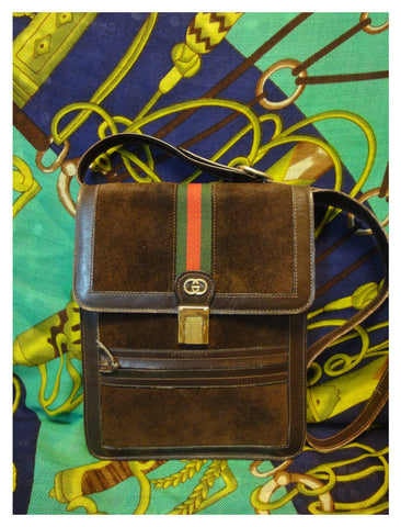 SOLD OUT: Vintage Gucci dark brown suede and webbing postman shoulder purse with gold-tone GG charm. Unisex. riri zipper
