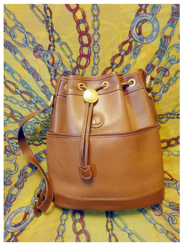 SOLD OUT: Vintage Gucci tanned brown leather hobo bucket shoulder purse with a golden charm and draw strings. Leather masterpiece