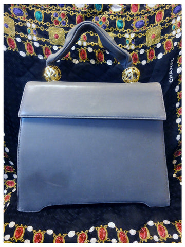 SOLD OUT: Vintage Salvatore Ferragamo light grey lamb leather handbag with gold tone decorative balls. Elegant and rare piece back in the era.