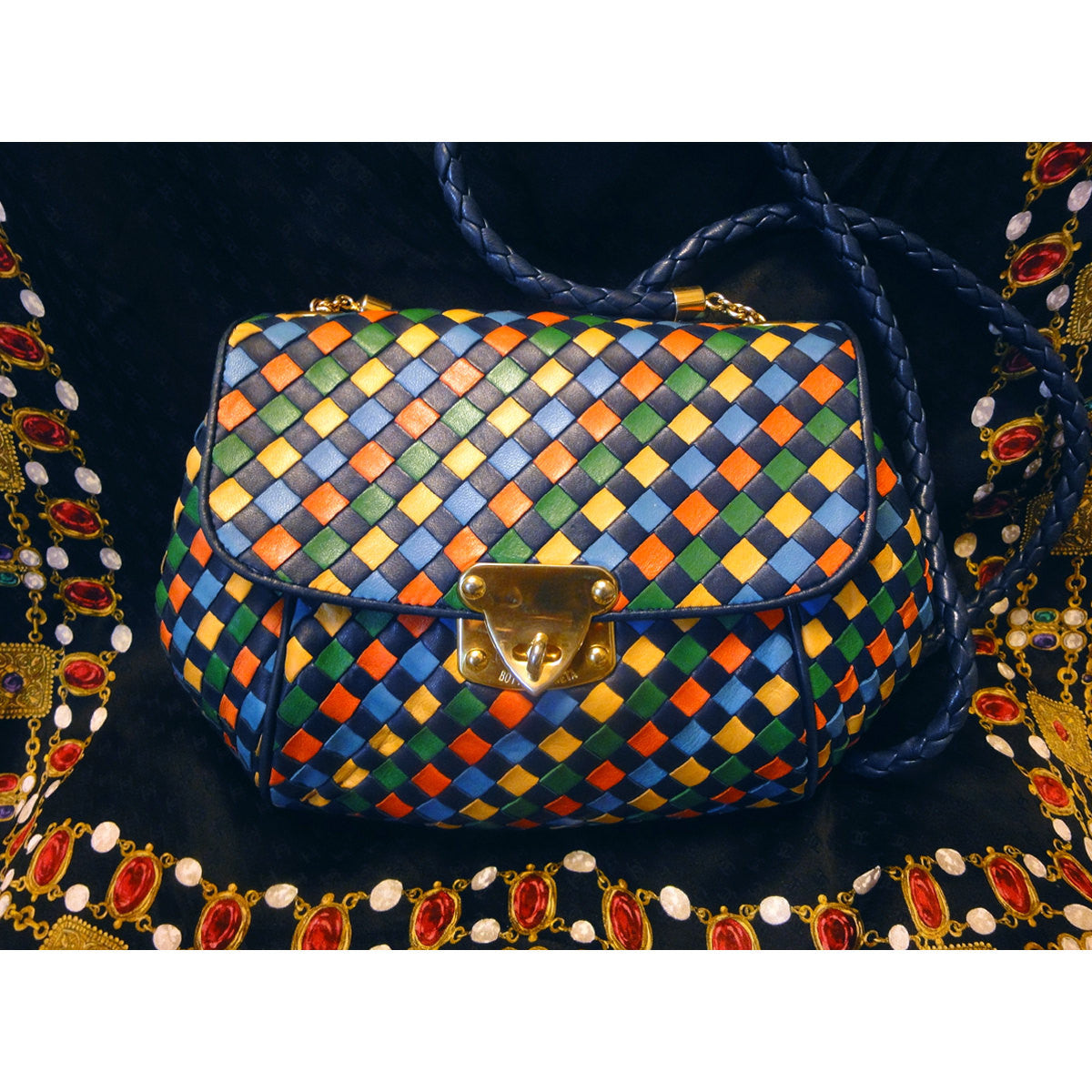 SOLD OUT: Vintage Bottega Veneta intrecciato woven leather shoulder purse in red, blue, green, yellow, and navy. Rare masterpiece. Cam be a clutch