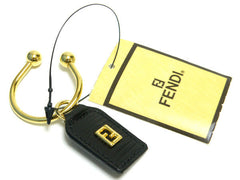 SOLD OUT: MINT. Vintage Fendi black leather key chain holder with a golden FF logo embossed mark. Unisex use. Great gift