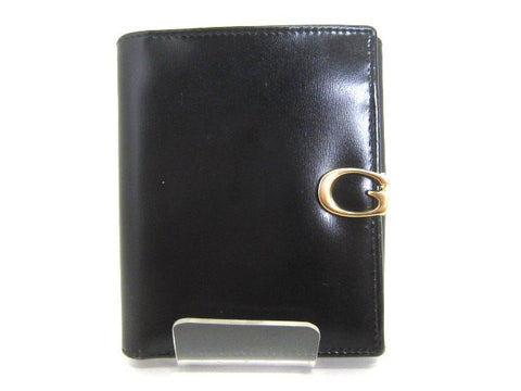 SOLD OUT: Vintage Gucci black leather wallet with G hardware closure. Great vintage gift piece for Gucci lovers and collectors.