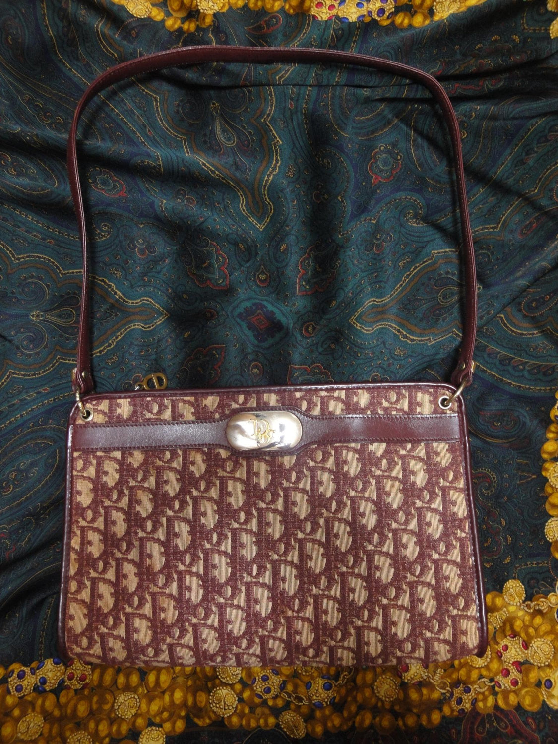 80's Christian Dior Vintage wine monogram jacquard and leather clutch shoulder bag with CD motif at front.