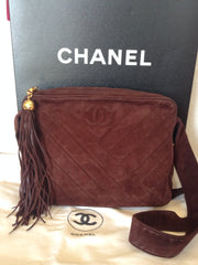 Vintage CHANEL dark brown V stitch suede leather shoulder bag with CC stitch mark and long tassel. Best Chanel purse for fall and winter.