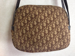70's vintage Christian Dior brown trotter jacquard handbag with the gold tone large CD motif. ECLAIR zippers. Unisex