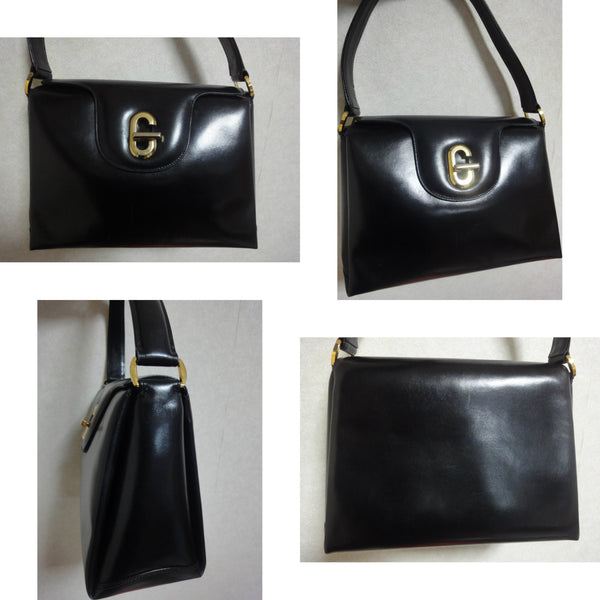 95b3c8d4bf04 ... Vintage Gucci black leather classic design handbag purse with G  hardware turnlock closure and red interior ...