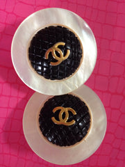 Vintage CHANEL extra large round shell earrings with black and golden CC motif. Great and rare Chanel vintage jewelry gift.