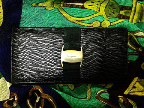 SOLD OUT: Vintage Salvatore Ferragamo black lizard embossed black leather long wallet with gold tone vara motif.