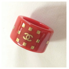 SOLD OUT: Vintage  CHANEL lipstick red thick plastic ring with gold tone square prints and CC mark. Gorgeous Chanel vintage jewelry. Perfect gift
