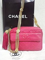 Vintage CHANEL pink lambskin camera bag style jewelry chain shoulder purse with a tassel and CC mark. Rare masterpiece