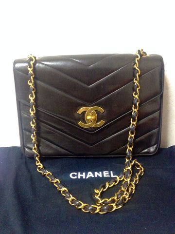 Vintage CHANEL black lamb leather large, jumbo size shoulder bag with big golden CC closure and chevron stitch. 2.55 classic shoulder purse.