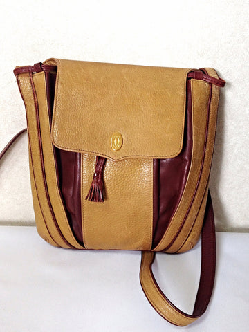 Vintage Cartier yellow mustard leather shoulder purse with gold-tone logo charm and wine leather tassel charm. Must de cartier collection