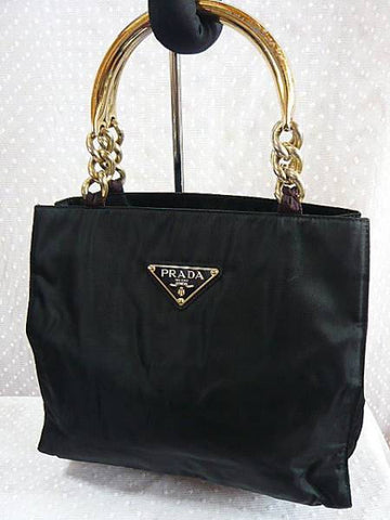 SOLD OUT: 90s Vintage Prada black nylon tote with gold tone metallic hardware handles and chains.