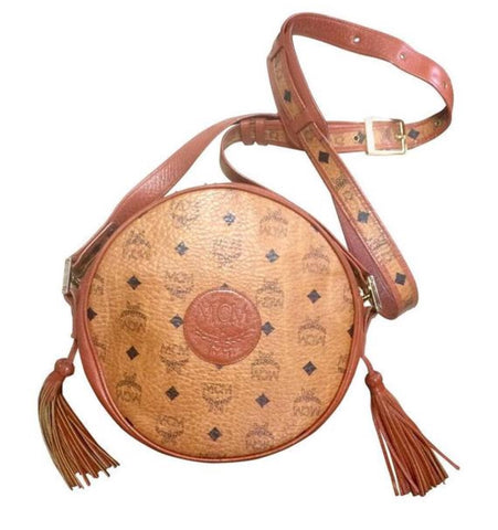 Vintage MCM brown monogram round Suzy Wong shoulder bag with brown leather trimmings. Designed by Michael Cromer. Classic and unisex bag.