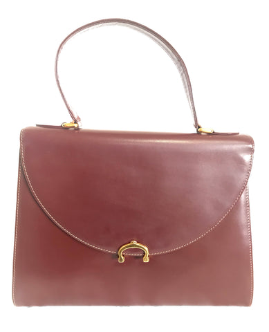 Vintage Cartier Kelly style wine leather handbag with gold-tone closure. les must de cartier collection. Made in Italy.