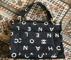 Vintage CHANEL black fabric canvas large tote bag with white Chanel CC logo print all over. Must have daily use vintage Chanel purse.