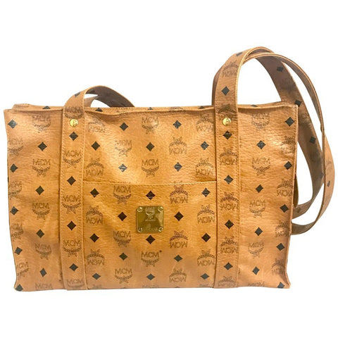 Vintage MCM brown monogram large tote bag with long straps. Classic style for unisex use. By Michael Cromer. Made in Germany. Classic bag.