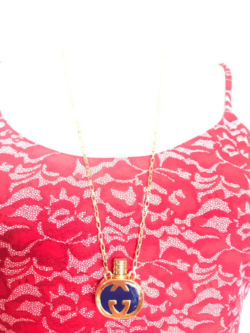 Vintage Gucci gold and navy round shape perfume bottle necklace with iconic logo mark. Perfect rare Gucci gift.