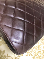 80's vintage Chanel dark brown quilted lambskin shoulder bag with CC motif and built-in chain shoulder strap. Rare Chanel purse