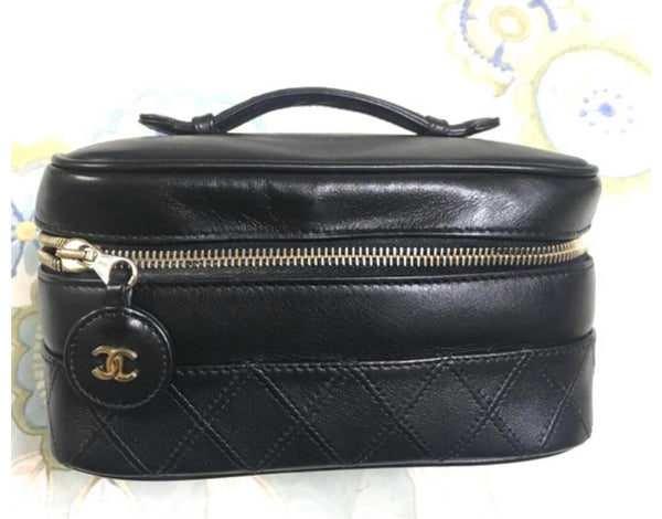 7c5045a90fe6 Vintage CHANEL calfskin classic cosmetic and toiletry black pouch, vanity  bag with CC charm.