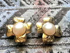 Vintage CHANEL large golden petal flower earrings with faux pearl and CC motif. So hot and chic item. Great gift.