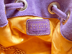 Vintage Christian Lacroix purple suede leather hobo bucket shoulder bag with drawstrings and golden sun, heart etc.. motifs. Unique and chic.