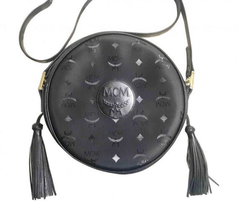 Vintage MCM black monogram round shape Suzy Wong shoulder bag with leather trimmings and fringes. Unisex. West Germany made.
