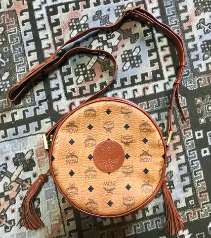 Vintage MCM brown monogram round Suzy Wong shoulder bag with brown leather trimmings. Designed by Michael Cromer. Masterpiece. Unisex bag.