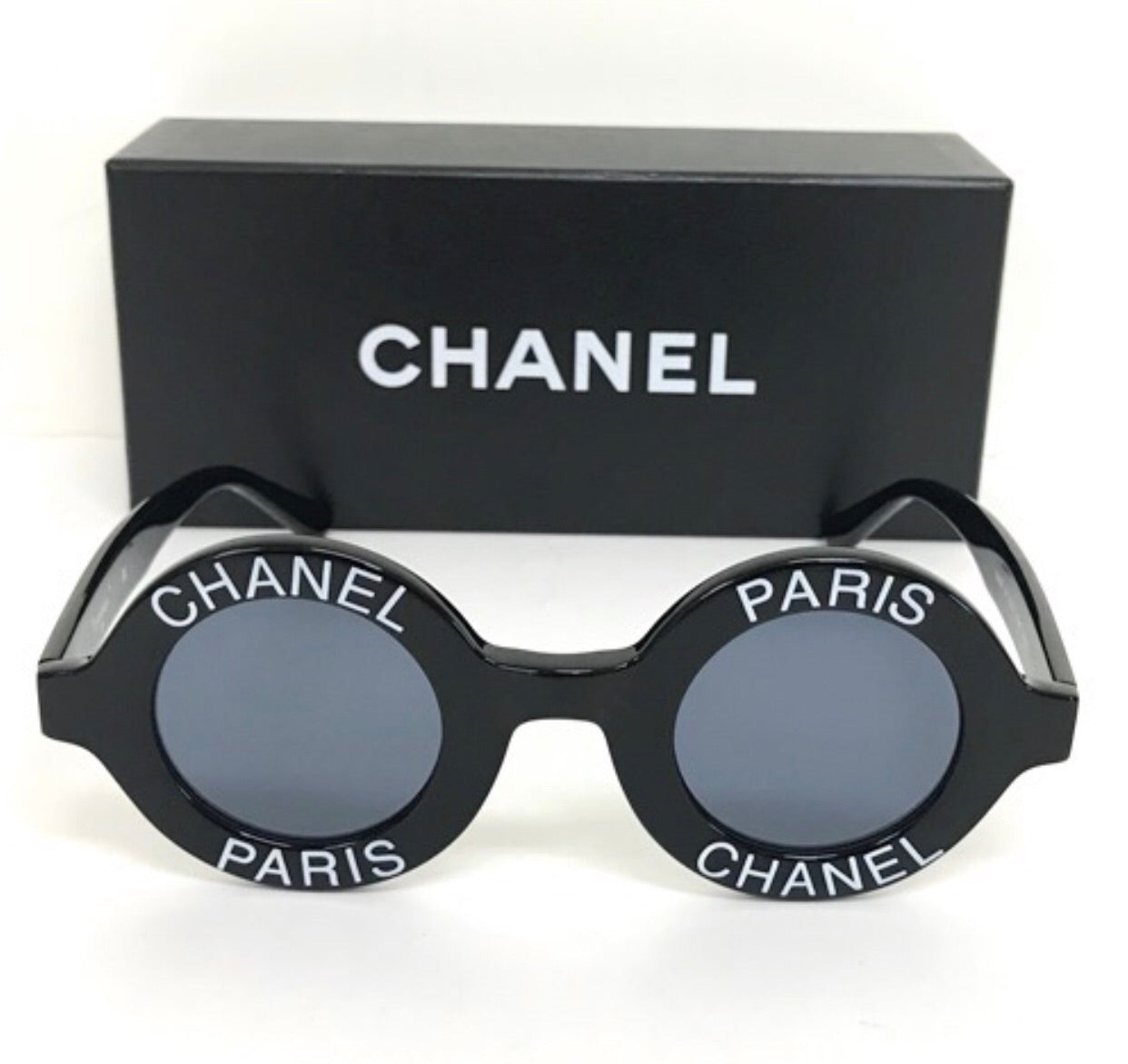 750b00e0ec517 Vintage CHANEL black round frame mod sunglasses with white CHANEL PARIS logo .