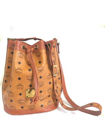 Vintage MCM brown monogram hobo bucket shoulder bag. Designed by Michael Cromer. Unisex use. Must have daily use bag.