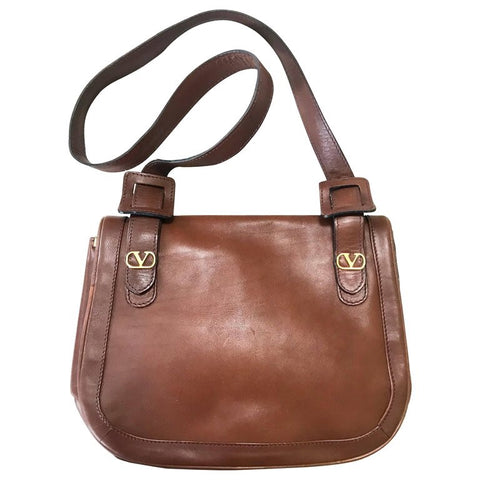 Vintage Valentino Garavani brown nappa leather shoulder bag with V logo motifs at front. Unisex and daily use.