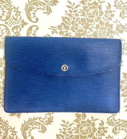 Vintage Louis Vuitton blue epi envelope style clutch bag with gold tone LV motif. Classic piece for unisex use.