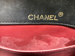 80's vintage CHANEL black lambskin shoulder bag with golden large CC closure and beak tip flap tip. Classic 2.55 bag.