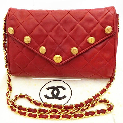 1980s. Vintage CHANEL red lamb leather shoulder bag with golden CC button motifs at flap. Rare purse.