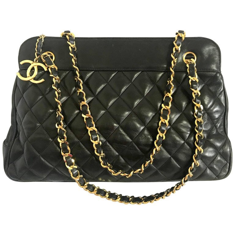 5835e10d6945 Vintage CHANEL black lambskin large tote bag with gold tone chains and  jumbo CC charm to