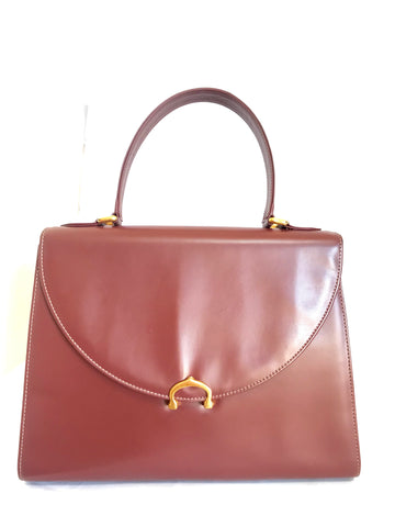 Vintage Cartier kelly style wine leather handbag with gold-tone closure.  les must de cartier collection.