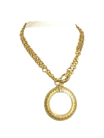 Vintage CHANEL long chain necklace with round glass loupe pendant top and CC motif. Can be worn in double. Gorgeous masterpiece.