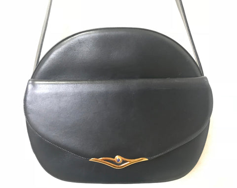 Vintage Cartier navy oval shape shoulder bag with blue stone and golden frame flap. Classic purse from Sapphire line.