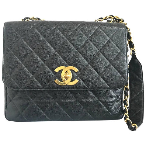 Vintage Chanel classic large black caviar leather 2.55 square shape chain shoulder bag with golden large CC closure. Must have purse.