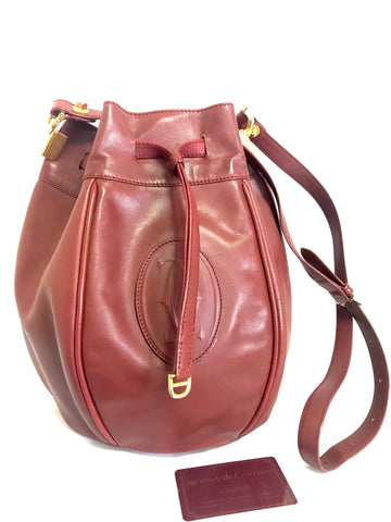 Vintage Cartier wine leather tulip 3 dimension round hobo bucket shoulder bag. Masterpiece from mist de cartier. Round and hexagon shape.