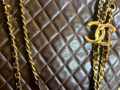 Vintage CHANEL brown lambskin large tote bag with gold tone chains and jumbo CC mark charm to the LAMPO zipper. Classic purse