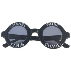 Vintage CHANEL black round frame mod sunglasses with white CHANEL PARIS logo.