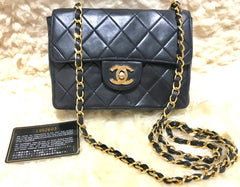Vintage CHANEL black leather 2.55 classic mini flap chain shoulder bag with gold tone CC closure.