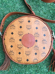 Vintage MCM brown monogram round Suzy Wong shoulder bag with brown leather trimmings. Designed by Michael Cromer. Made in Germany.