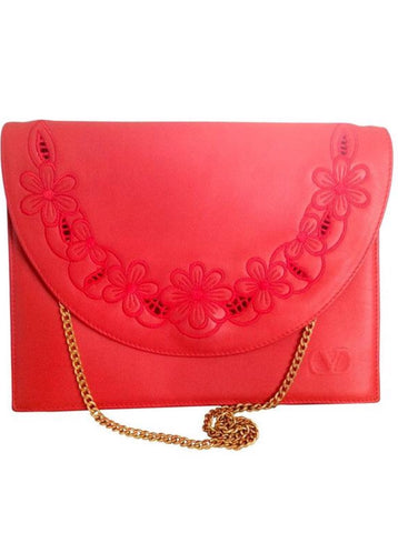 Vintage Valentino Garavani red leather clutch shoulder bag with red flower embroidery deco on the flap and V logo.