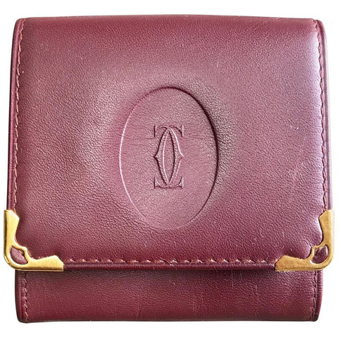 Vintage Cartier genuine wine leather square coin case with gold tone frames. must de Cartier. Unisex use.
