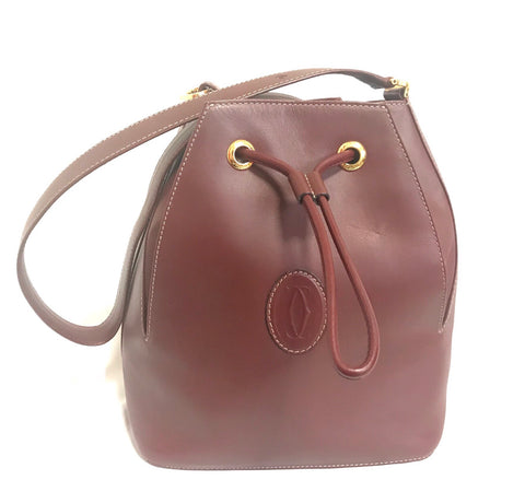 Vintage Cartier wine hobo bucket shoulder bag. Classic purse from must de Cartier collection.