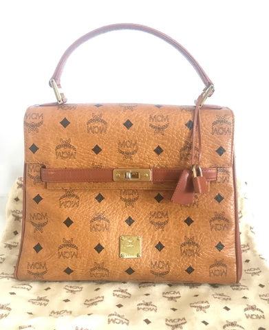 Vintage MCM classic brown monogram Kelly bag with golden logo plate. Perfect daily use bag.  By Michael Cromber, Germany